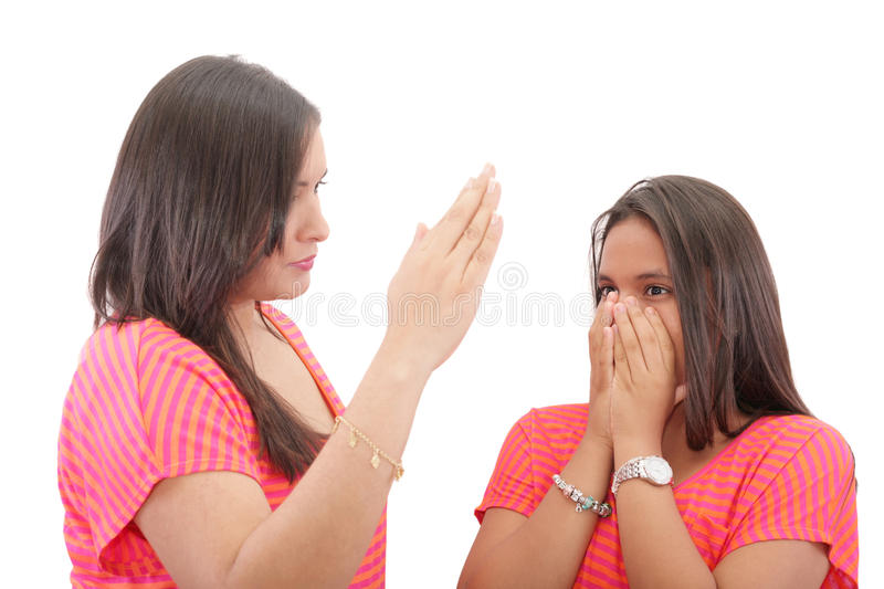 Mother preparing to slap her daughter in the face stock photography