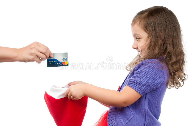 Mother presents credit card for daughter royalty free stock photos