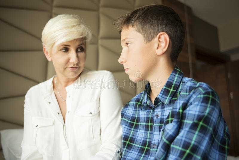 Mother and a problem teenager talking stock photo