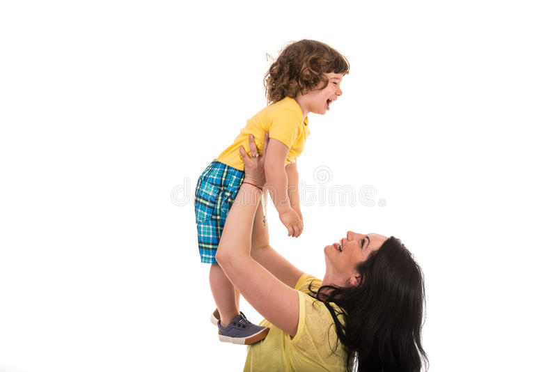 Mother raising laughing son stock images