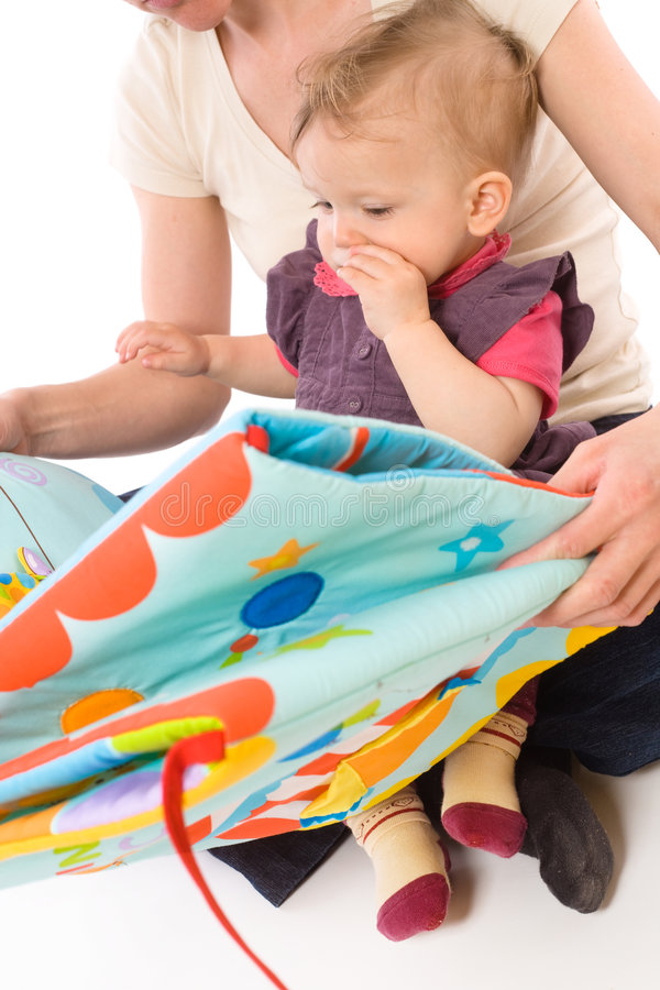 Mother reading for baby royalty free stock photography