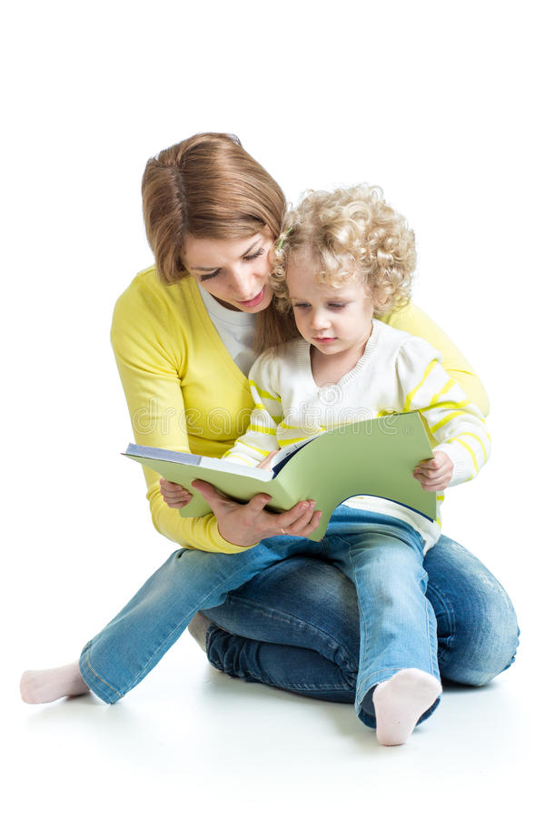 Mother reading a book to kid royalty free stock images