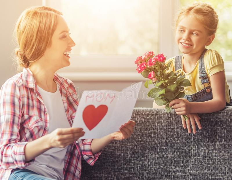 Mother Reading Greeting Card from Her Daughter. royalty free stock image