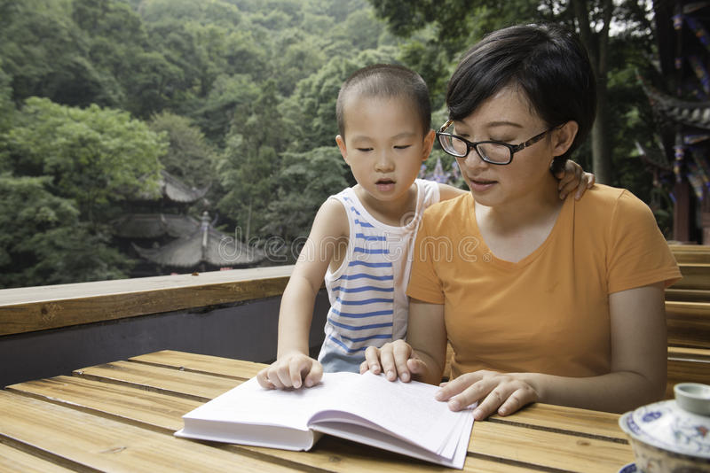 Mother reading for son royalty free stock photos