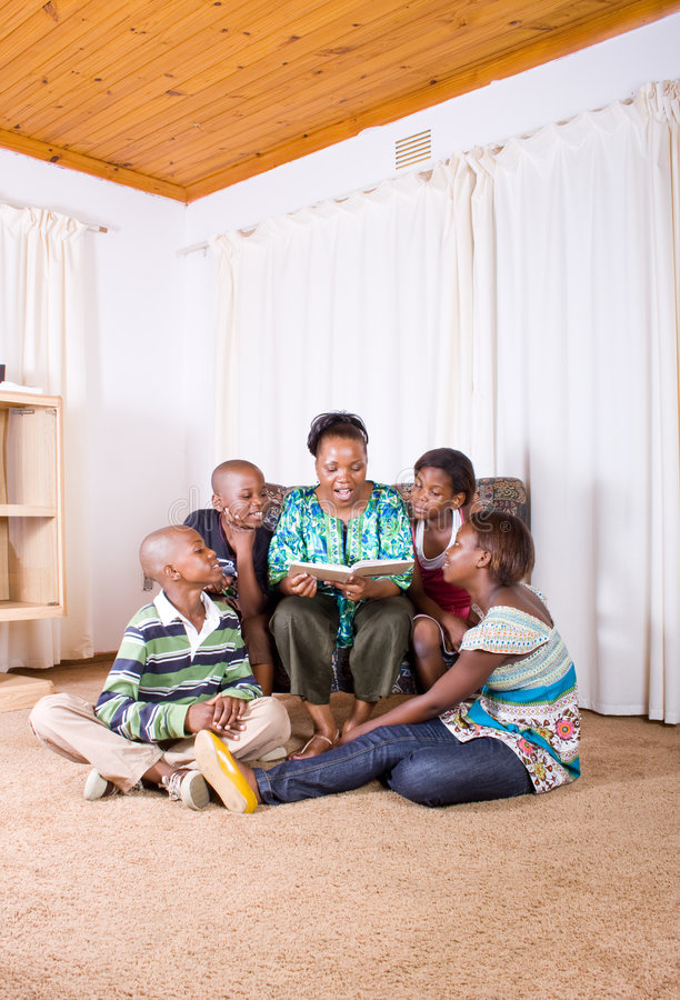 Mother reading story to children royalty free stock photos