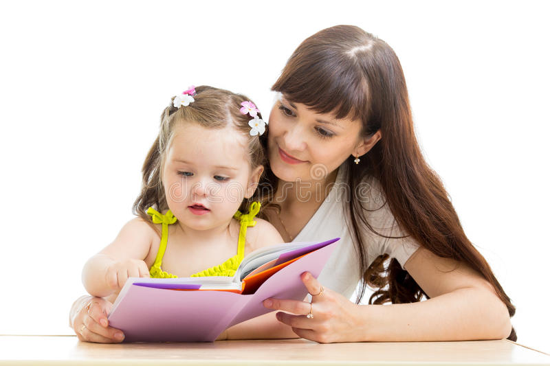 Mother reads a book to her kid stock images