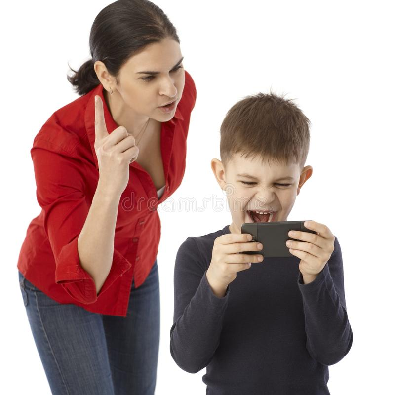 Mother rebuking naughty little boy stock image