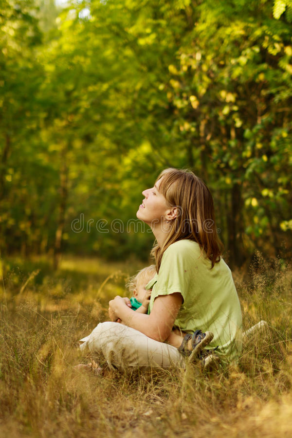 Mother relax in nature royalty free stock image