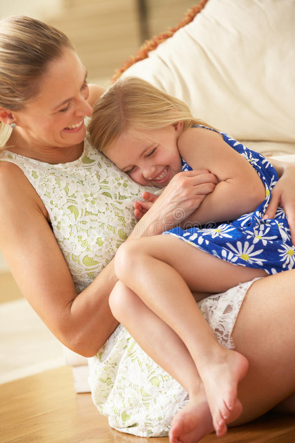 Download Mother Relaxing At Home With Daughter Stock Photo - Image: 26614704