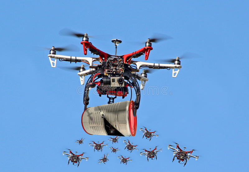Mother releases baby drones stock photos