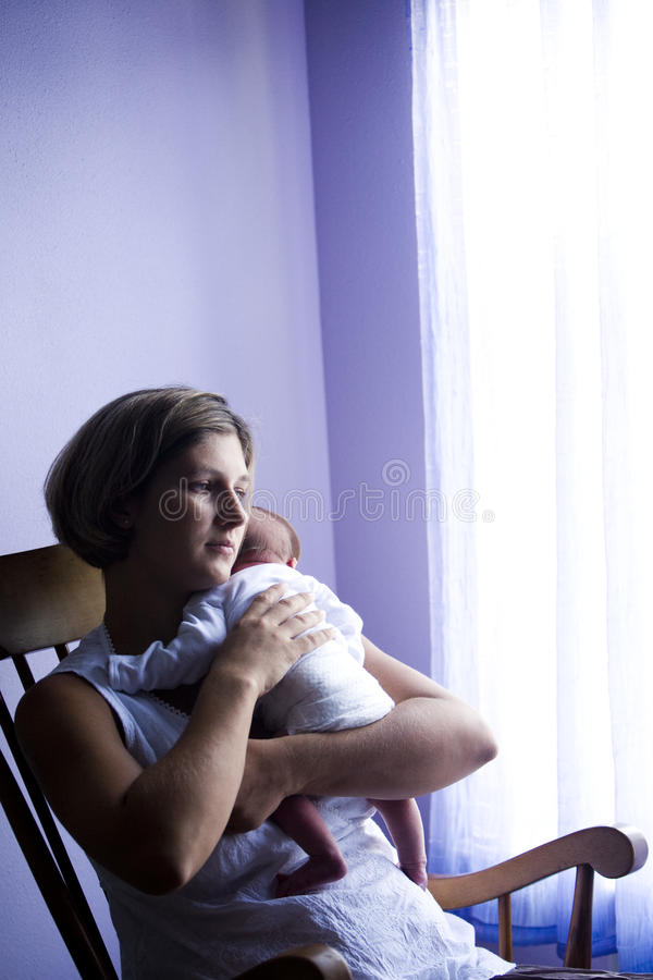 Download Mother Rocking Newborn Baby By Window Stock Image - Image of caucasian, male: 10549919