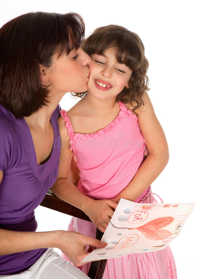 For mother's day. Little girl giving her mother a drawing for mother's day stock images