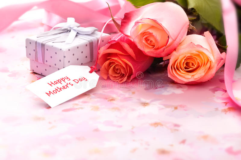 Mother's day. Bouquet of roses and gift box with a mothers day card royalty free stock photo