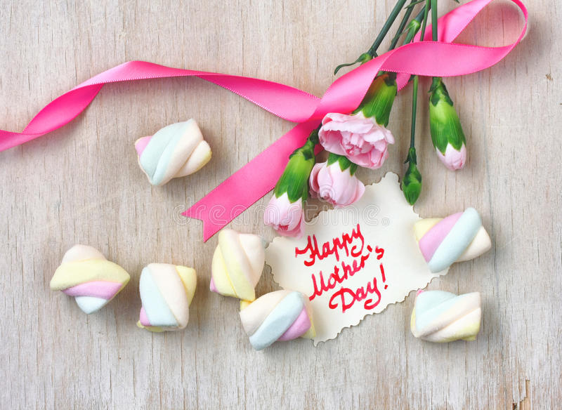 Mother`s day card, pink carnations and marshmallows royalty free stock image