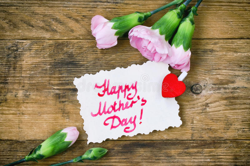 Mother`s Day card, pink carnations and note stock photography