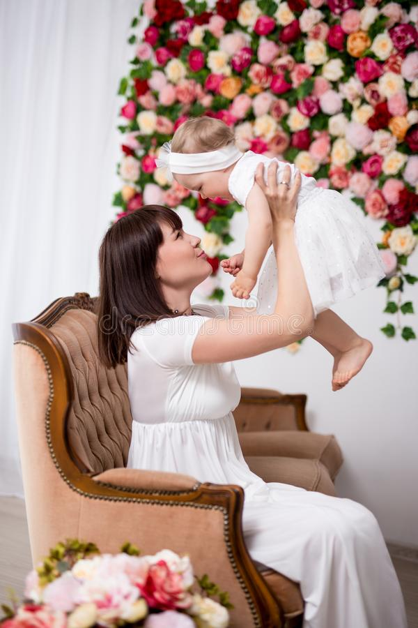 Mother`s day concept - happy beautiful mother playing with little daughter stock photo