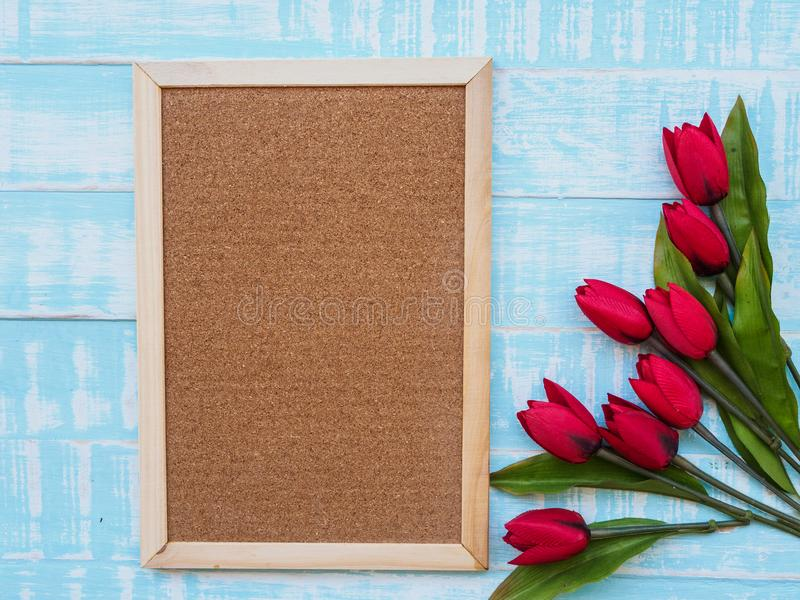 Mother`s day concept. tulips flower on pastel blue wooden backgr royalty free stock photography