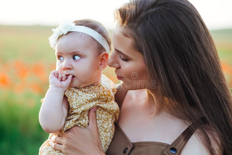 Mother`s Day and daughters. Advertising family values and traditions. Nice, family, good photo of mother and daughter. Mother`s Day and daughters. Advertising stock photography