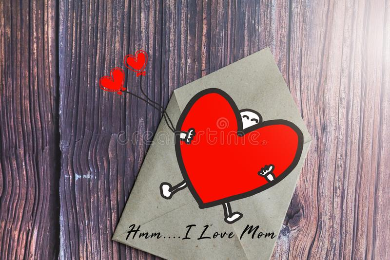 Mother`s day gift card with word I Love Mom, greeting card stock photo