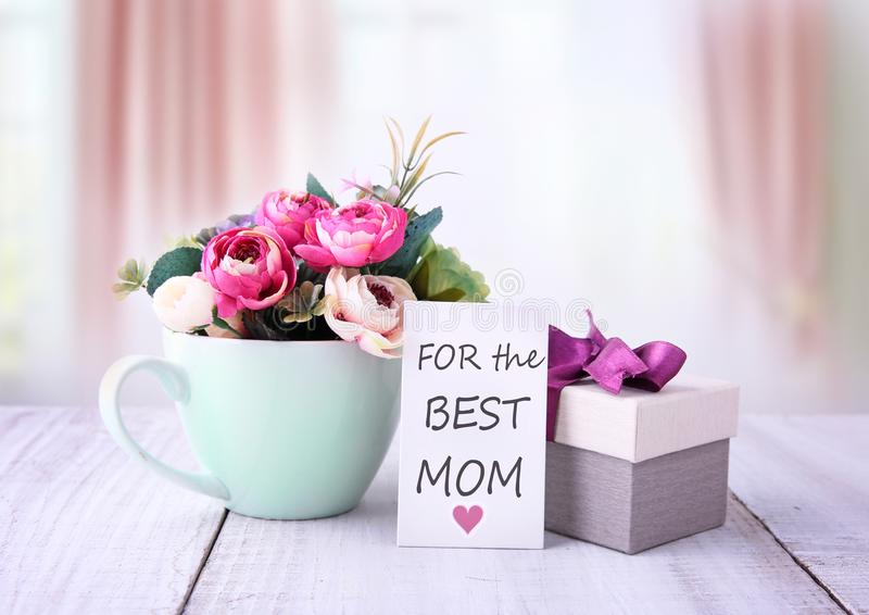Mother`s day greeting card. Flowers and gift box. stock photos