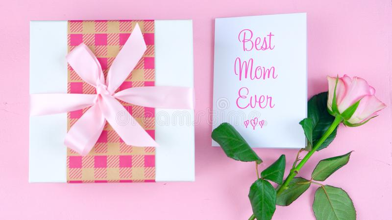 Mother`s Day overhead with rose, Best Mom Ever card and gift on pink table. royalty free stock photo