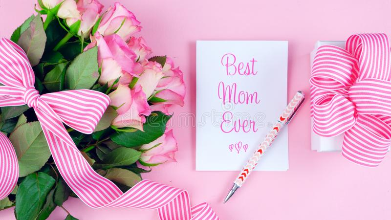 Mother`s Day overhead with roses, Best Mom Ever card and gift on pink table. stock photos