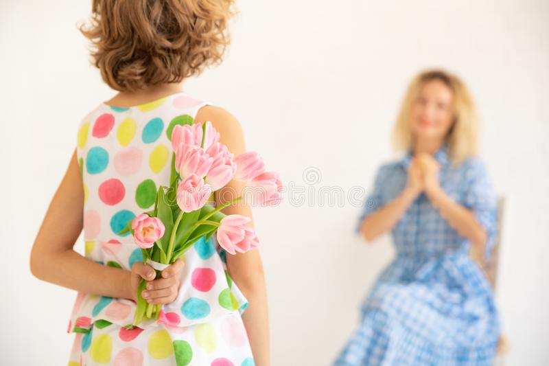Mother`s day spring holiday concept. Child giving women bouquet of tulips. Mother and daughter having fun together. Spring family holiday concept. Mother`s day royalty free stock photo