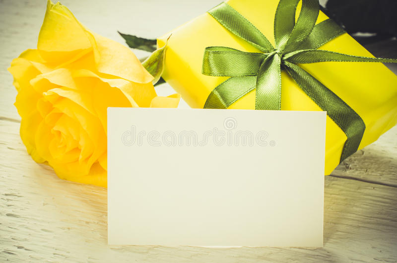 Mother`s day, Valentine`s or birthday concept. Present, roses and empty card. Mother`s day, Valentine`s or birthday concept. Present and yellow roses with empty stock image