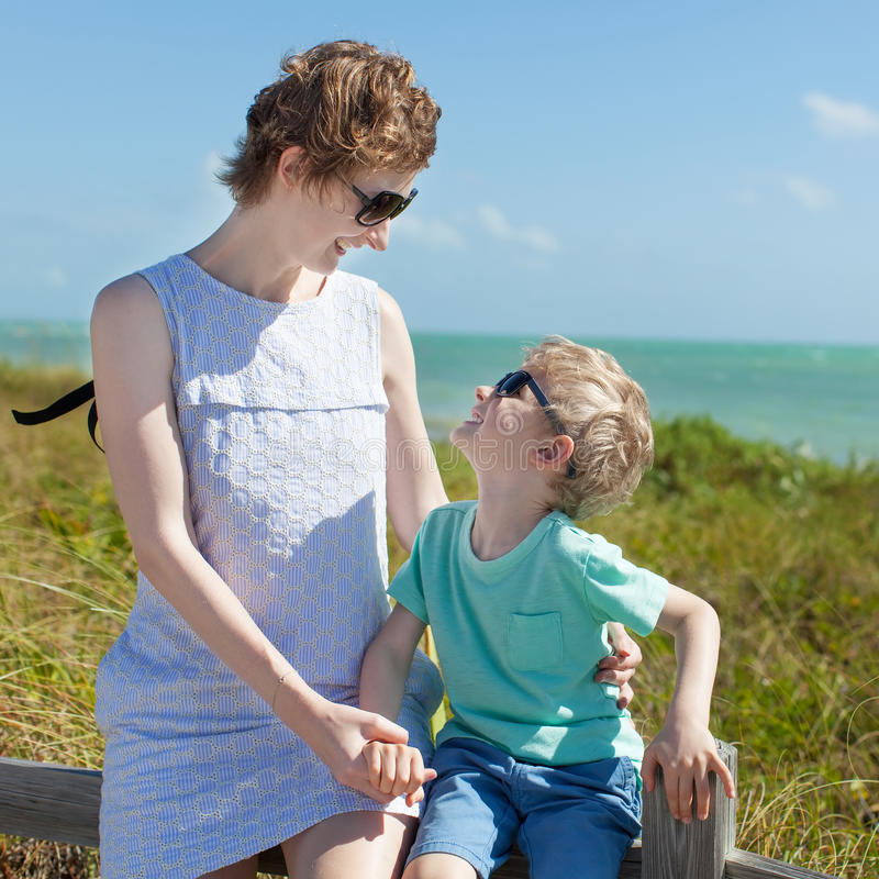 Happy Couple Sitting On Sandy Beach Embracing Kissing: Young Mother Hugging Her Son Beach Stock Photos