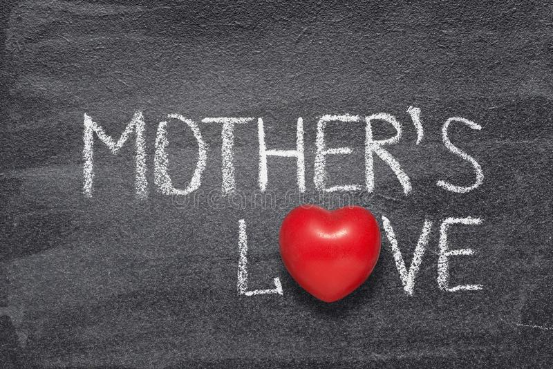 Mother`s love heart. Mother`s love phrase written on chalkboard with red heart symbol instead of O stock illustration