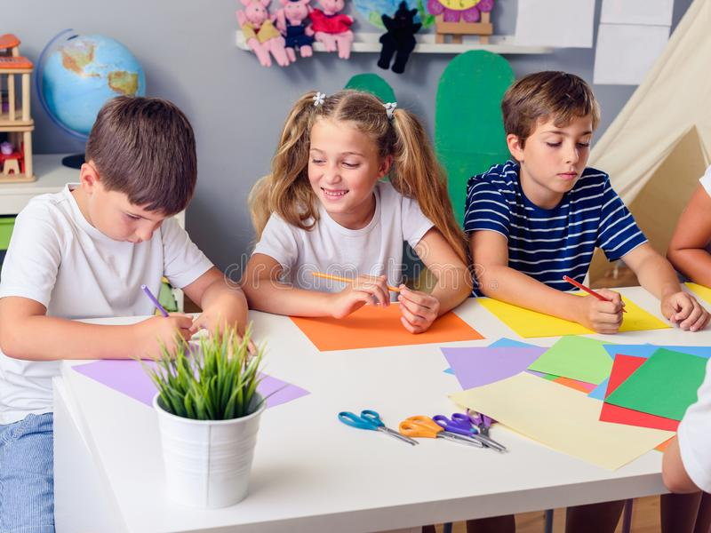 Mother or school teacher with children. Creative arts and crafts project at school or at home. Creative kids. Creative Arts and Crafts Classes in After School royalty free stock photos