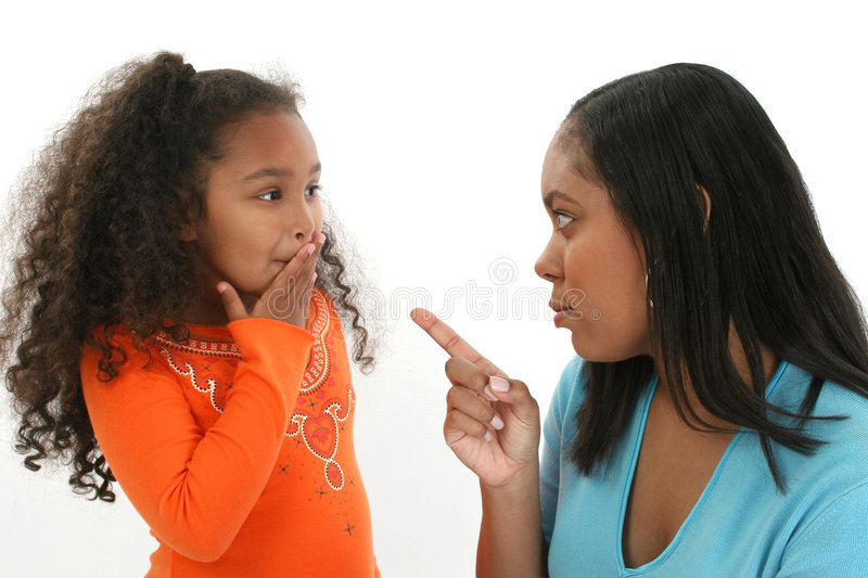Mother Scolding Daughter. Mother scolding her young daughter stock photos