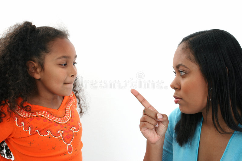 Mother scolding daughter. African American mother scolding her daughter, on white studio background royalty free stock images