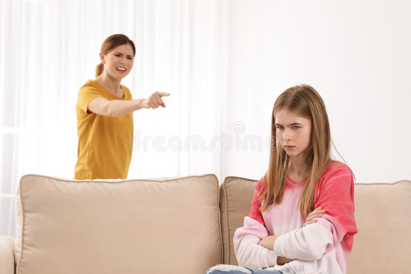 Mother scolding her teenager daughter royalty free stock image