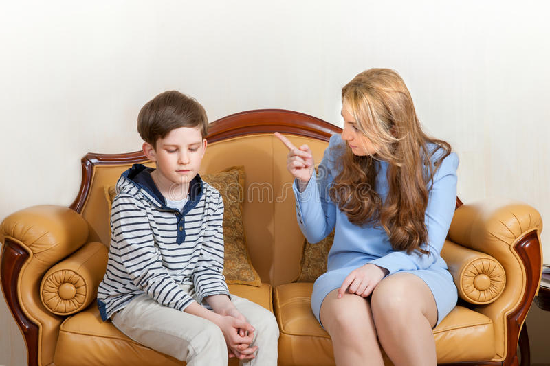 Mother scolds son stock image