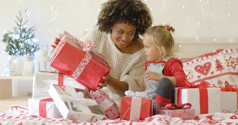 Mother showing child a large Christmas gift royalty free stock images