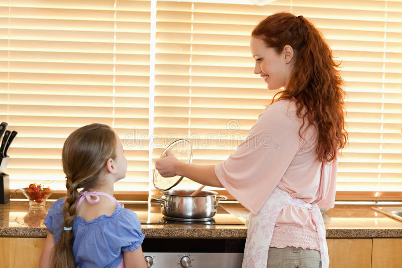 Download Mother Showing Her Daughter What Shes Cooking Stock Photo - Image of family, domestic: 22439234