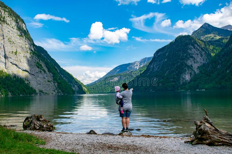Mother shows the little daughter the Königssee royalty free stock photography