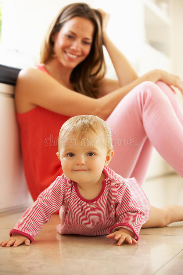 Mother Sitting With Baby Daughter At Home royalty free stock photos