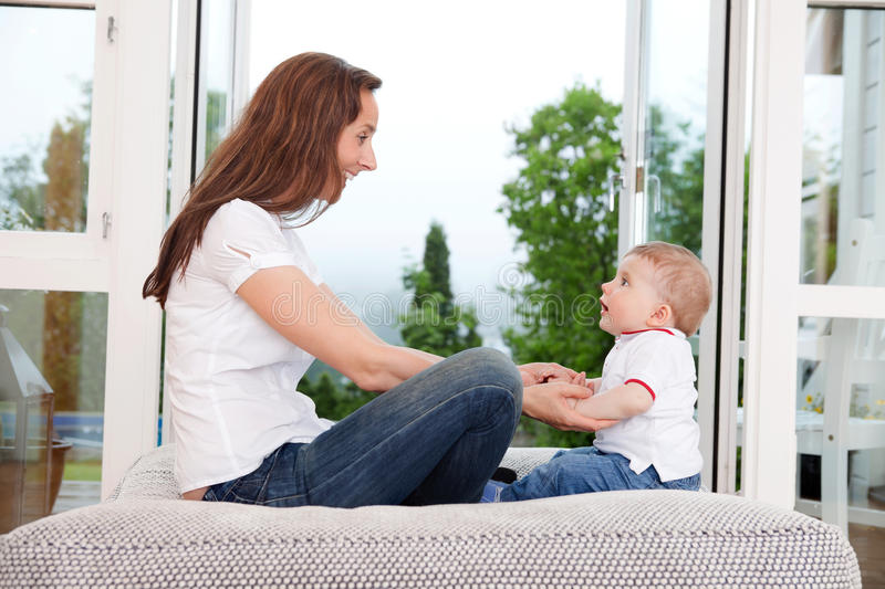 Mother sitting with her child royalty free stock photos