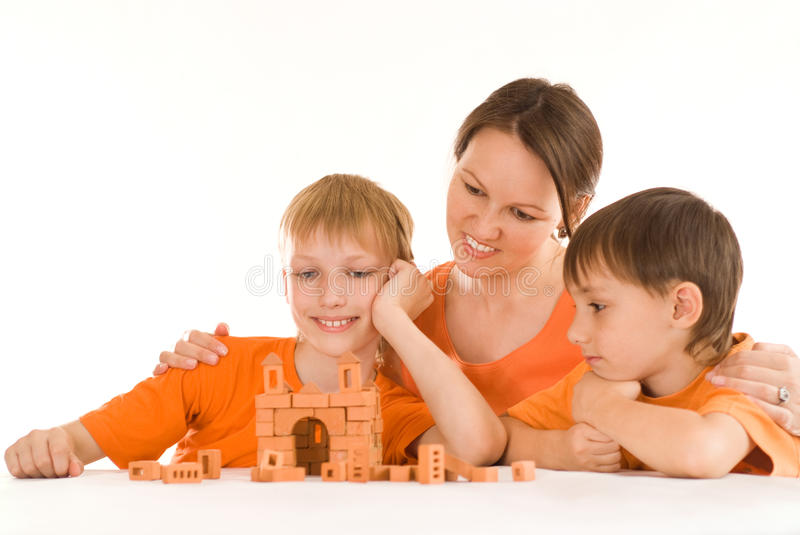 Mother sitting with sons royalty free stock photo