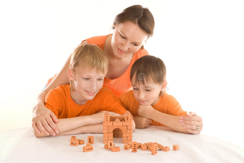Mother sitting with sons royalty free stock images