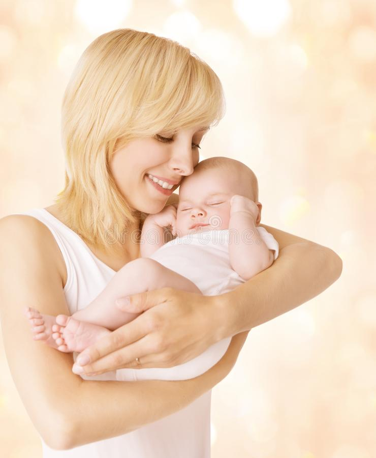 Mother and Sleeping Baby, Happy Mom Hold Newborn Kid on Hands. Mother and Sleeping Baby, Mom Hold Newborn Kid on Hands, Happy Woman with New Born Child Family stock photos