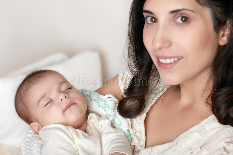 Mother with sleeping baby portrait, happy maternity concept royalty free stock photography