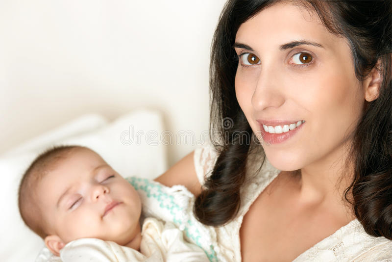 Mother with sleeping baby portrait, happy maternity concept stock image