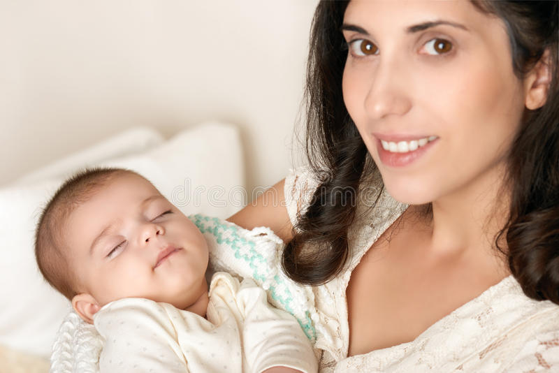 Mother with sleeping baby portrait, happy maternity concept. Mother with sleeping portrait, happy maternity concept royalty free stock photos