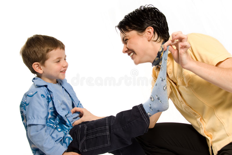Mother and son. Playing with blue socks royalty free stock images