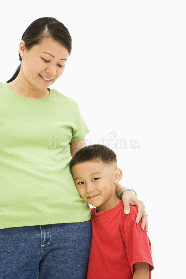 Mother and son. Asian mother standing with arm around son royalty free stock image