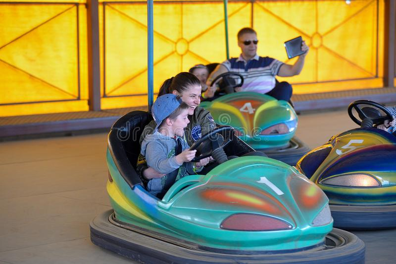 Mother and son in amusement park ride on car.  royalty free stock photos
