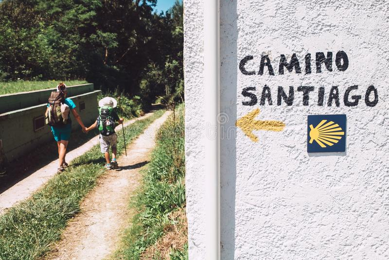 Mother and son as a pilgrims walk on St.Santiago Way, North Spain royalty free stock image